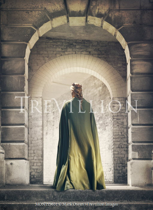 Mark Owen Young woman in green cloak and crown in archway