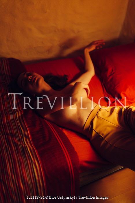 Ihor Ustynskyi Topless woman lying on bed