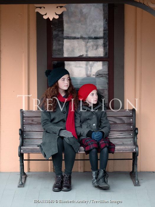 Elisabeth Ansley TWO GIRLS SITTING ON BENCH OUTDOORS Children