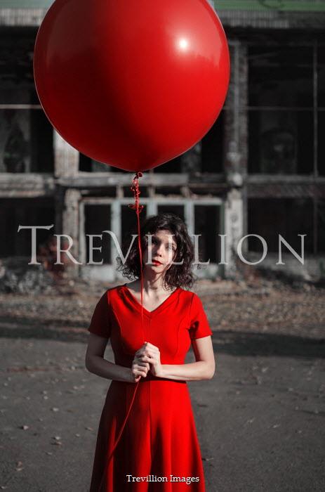 Svitozar Bilorusov SERIOUS WOMAN HOLDING RED BALLOON OUTDOORS Women