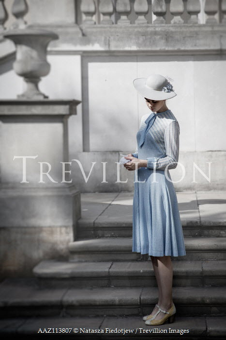Natasza Fiedotjew Young vintage lady standing on steps outside manor Women