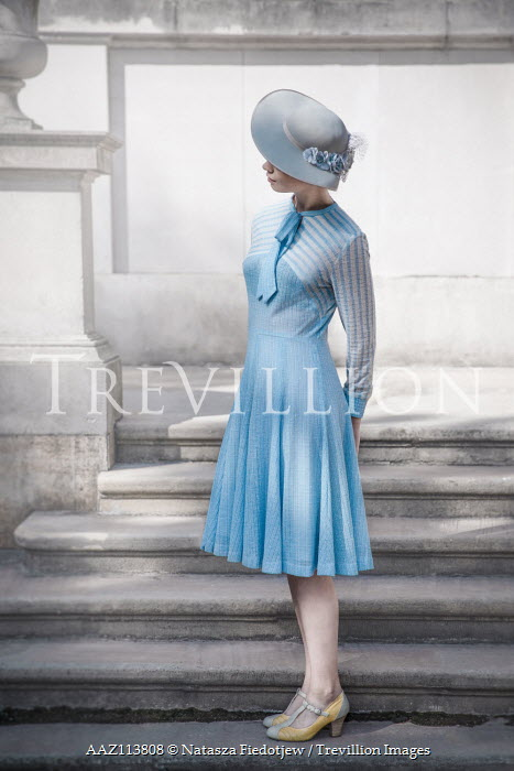 Natasza Fiedotjew Young vintage lady standing on stpes outside manor Women