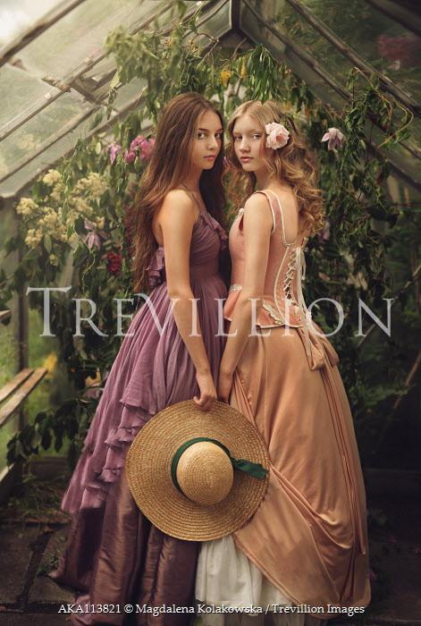 Magdalena Kolakowska TWO GIRLS IN LONG DRESSES IN GREENHOUSE Women