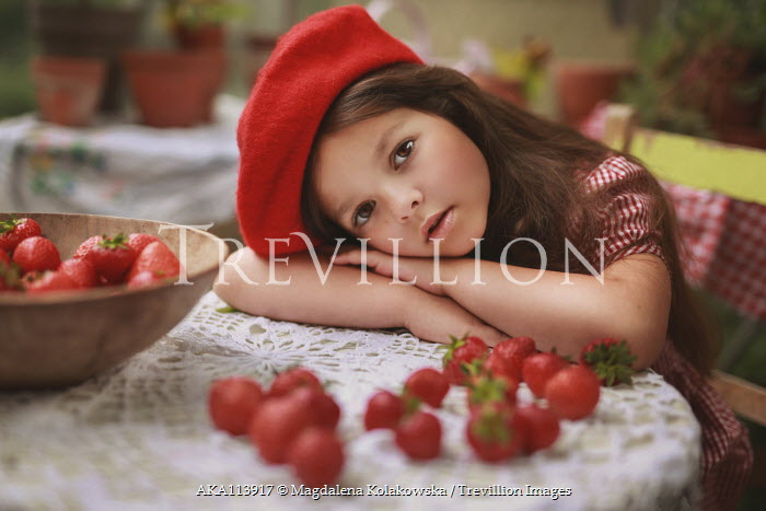 Magdalena Kolakowska Girl in red beret leaning on table with strawberries