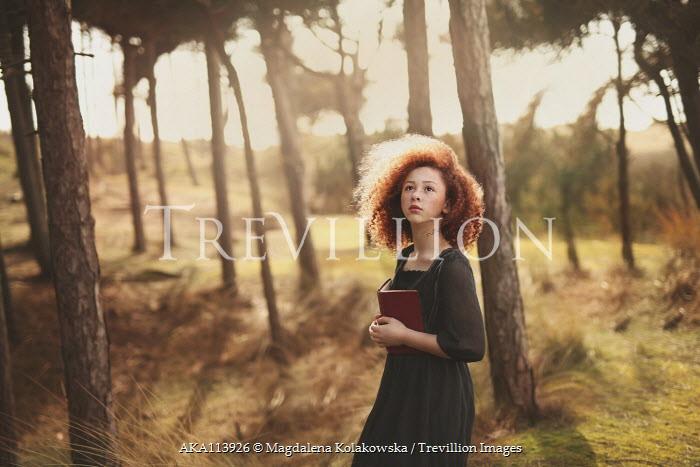 Magdalena Kolakowska Teenage girl with book in forest