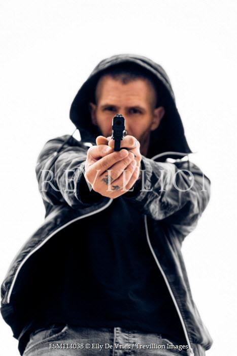 Elly De Vries Man in hoodie with pistol