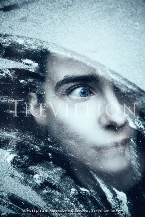 Magdalena Russocka scared woman behind snowy window