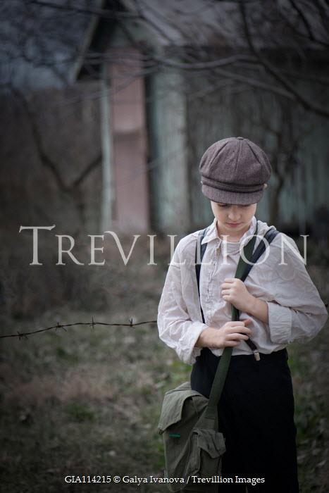 Galya Ivanova Boy carrying satchel in field