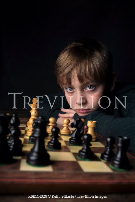 Kelly Sillaste SERIOUS YOUNG BOY WITH CHESS SET Children