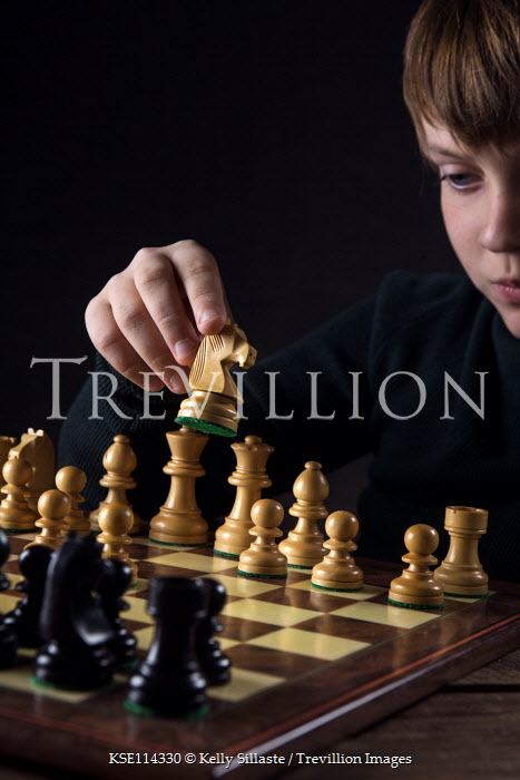 Kelly Sillaste YOUNG BOY PLAYING WITH CHESS SET Children