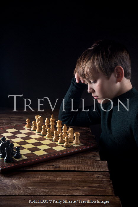 Kelly Sillaste THOUGHTFUL YOUNG BOY WITH CHESS SET Children