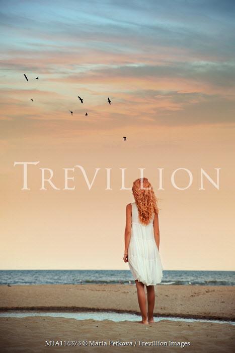 Maria Petkova woman in dress standing on beach at sunset Women