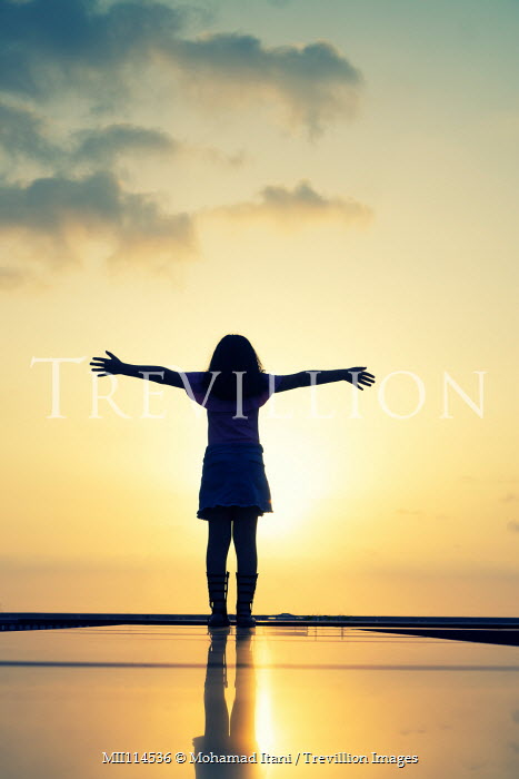 Mohamad Itani GIRL WITH OUTSTRETCHED ARMS ON BEACH AT SUNSET Children