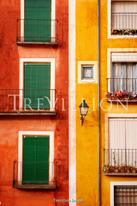 Tim Robinson EXTERIOR OF RED AND YELLOW PAINTED APARTMENTS Houses