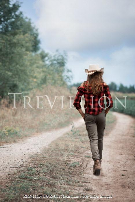 Robin Macmillan TEENAGE GIRL IN COWBOY HAT IN COUNTRYSIDE Children