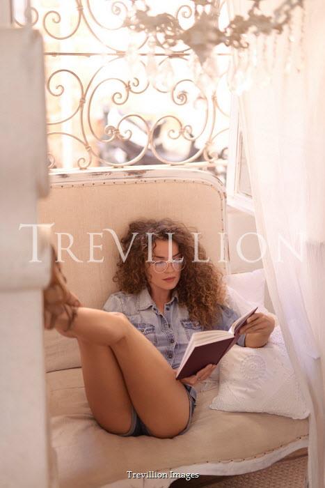 Alex Maxim WOMAN SITTING BY WINDOW READING INDOORS Women