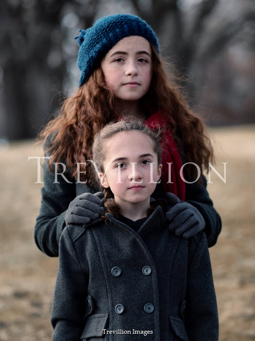 Elisabeth Ansley GIRL HUGGING YOUNG FEMALE OUTDOORS IN WINTER Children