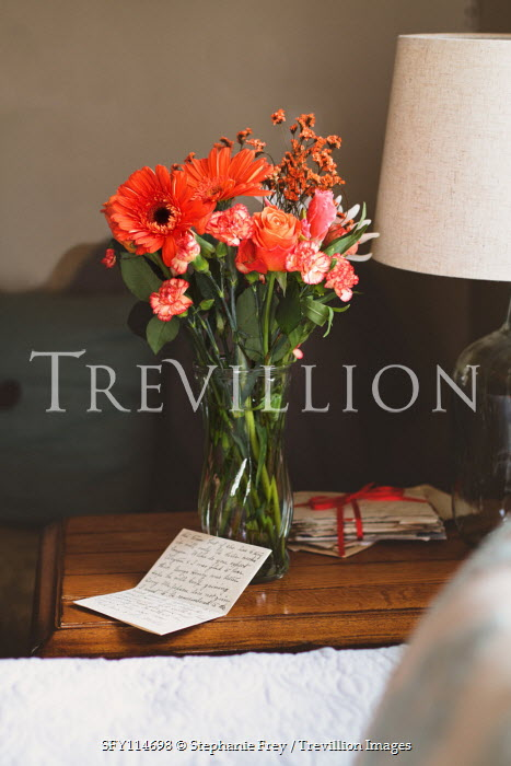 Stephanie Frey VASE OF FLOWERS WITH LETTER BY BED Flowers
