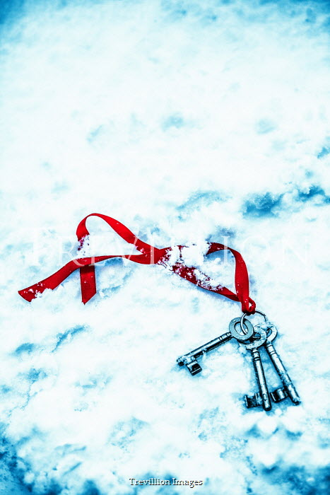 Magdalena Russocka bunch of keys with red ribbon dropped in snow