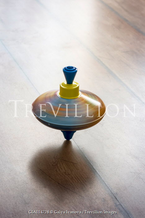 Galya Ivanova SPINNING TOP ON WOODEN FLOOR Miscellaneous Objects