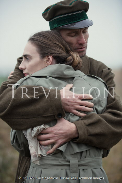 Magdalena Russocka close up of wartime couple embracing in field Couples