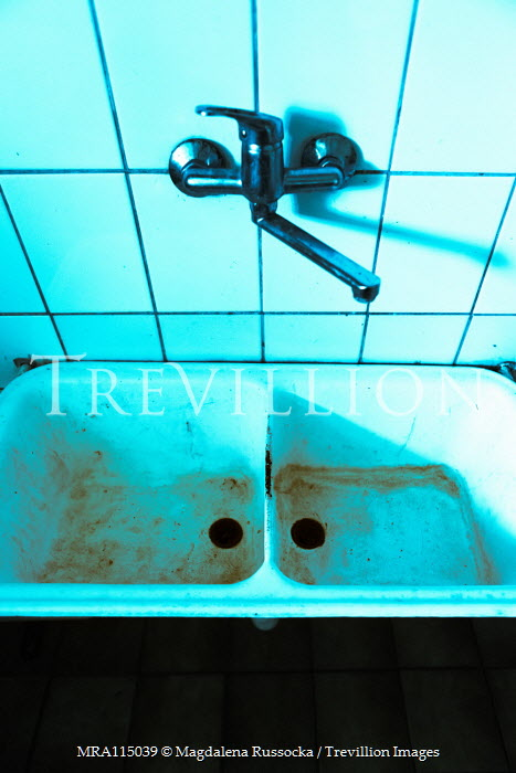 Magdalena Russocka stained old sink with tap in derelict room