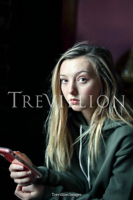 Stephen Carroll SAD TEENAGE GIRL WITH MOBILE PHONE Women