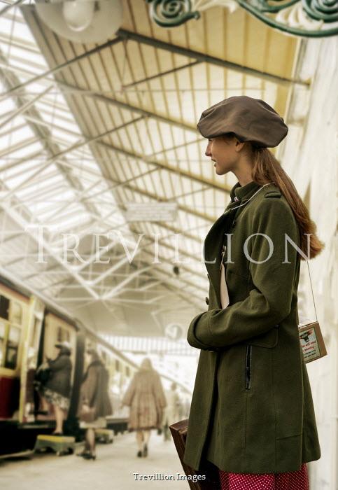 Stephen Mulcahey WARTIME TEENAGE GIRL STANDING IN TRAIN STATION Children