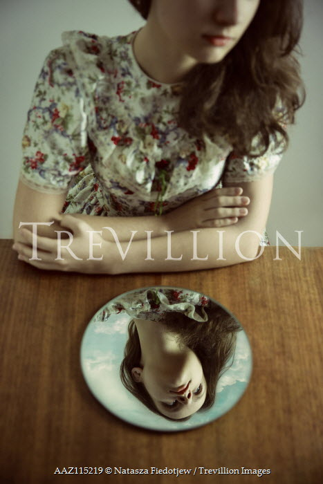Natasza Fiedotjew Reflection in mirror of young girl in floral vintage dress surrounded by clouds