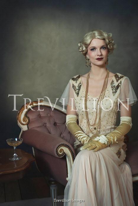 Ysbrand Cosijn Young woman in 1920s dress sitting on sofa