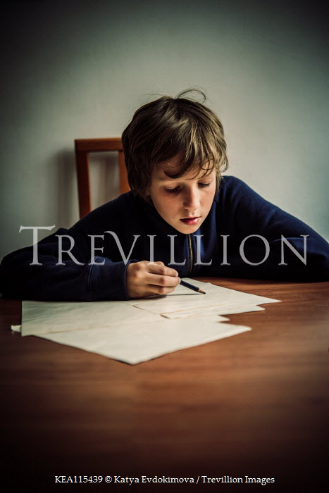 Katya Evdokimova Boy drawing at table