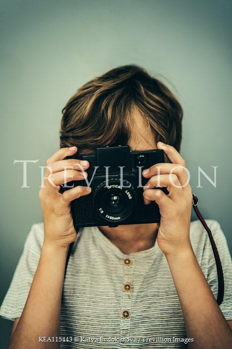 Katya Evdokimova Boy with vintage camera