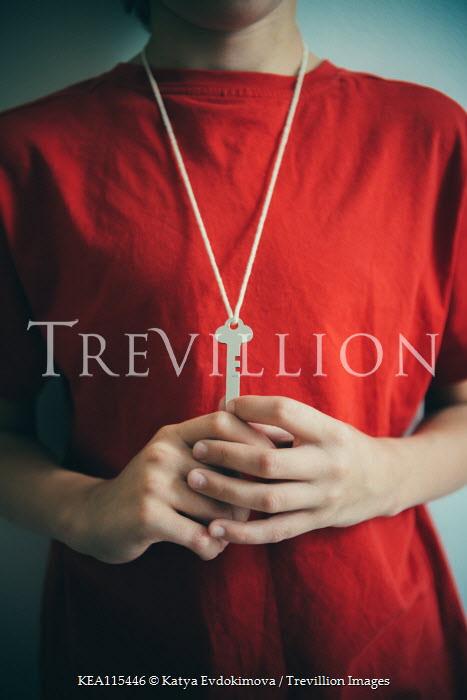 Katya Evdokimova Boy in red shirt with key on string