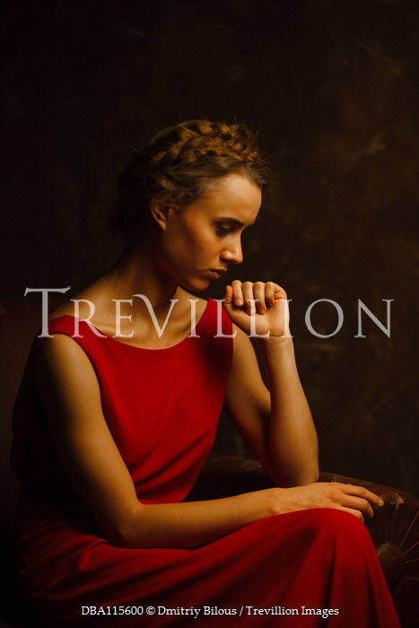 Dmitriy Bilous Sitting woman in red dress with plaited hair