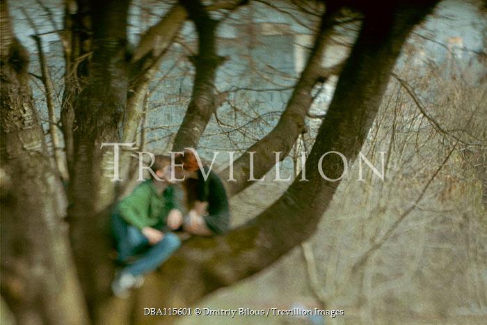 Dmitriy Bilous Teenage couple kissing in tree