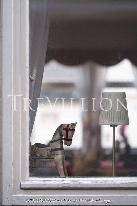 Maria Petkova Toy horse and lamp in window