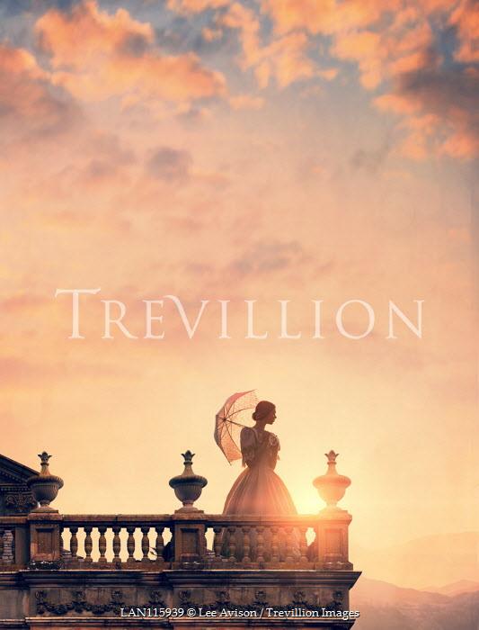 Lee Avison Victorian woman standing on terrace at sunset