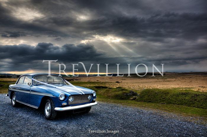 Maggie McCall Blue vintage car on rural road