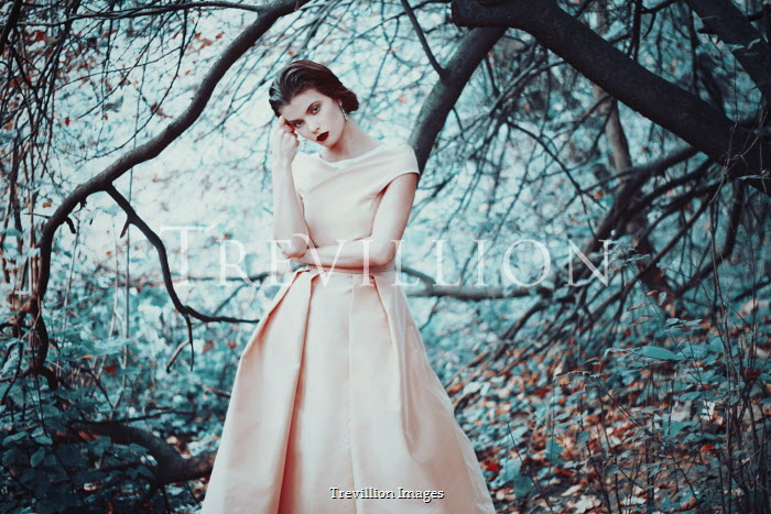 Felicia Simion Young woman in pink dress under tree
