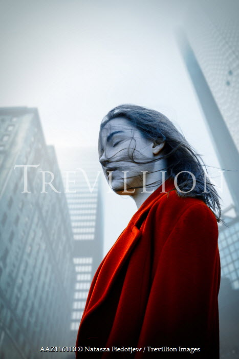 Natasza Fiedotjew Young woman in red coat surrounded by skyscrapers