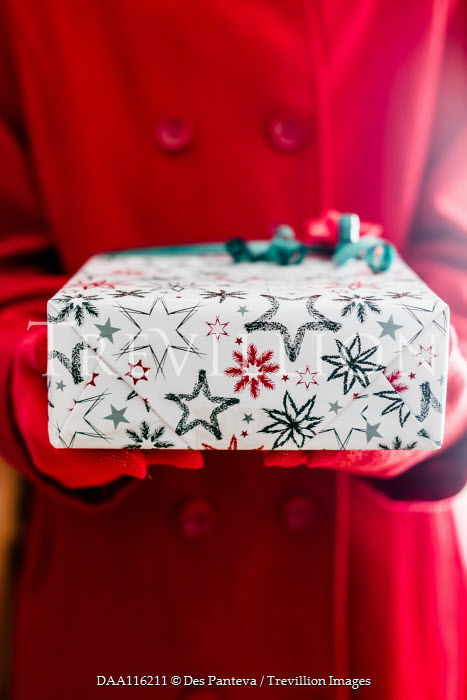 Des Panteva WOMAN HOLDING GIFT WITH CHRISTMAS WRAPPING PAPER Women