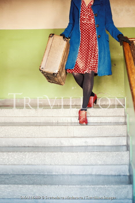 Svetoslava Madarova GIRL CARRYING SUITCASE ON STEPS IN BUILDING Women
