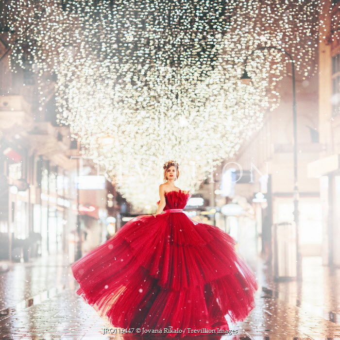 Jovana Rikalo WOMAN IN GOWN IN URBAN STREET WITH LIGHTS Women