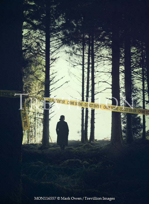 Mark Owen SILHOUETTED WOMAN IN FOREST WITH POLICE TAPE Women