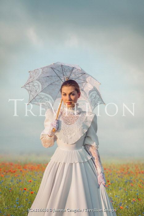 Joanna Czogala Victorian woman with parasol in field