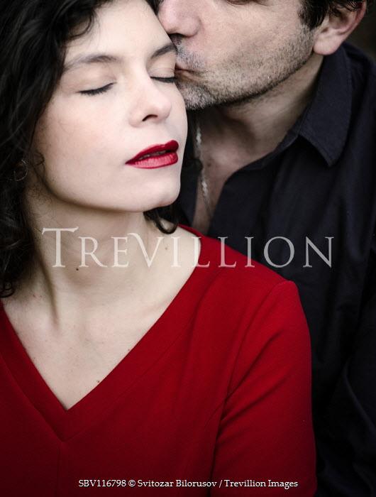 Svitozar Bilorusov Man kissing woman on cheek