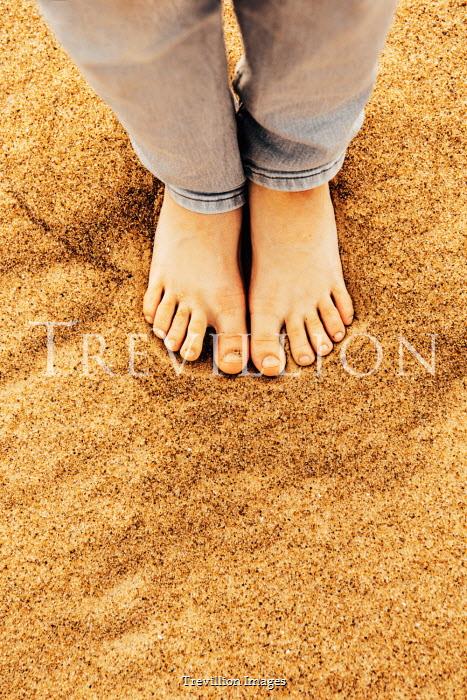 Katya Evdokimova Boy's bare feet in sand on beach