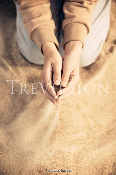 Katya Evdokimova Hands of boy playing with sand on beach