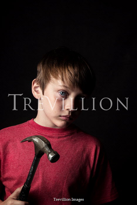Kelly Sillaste Boy in red shirt with hammer
