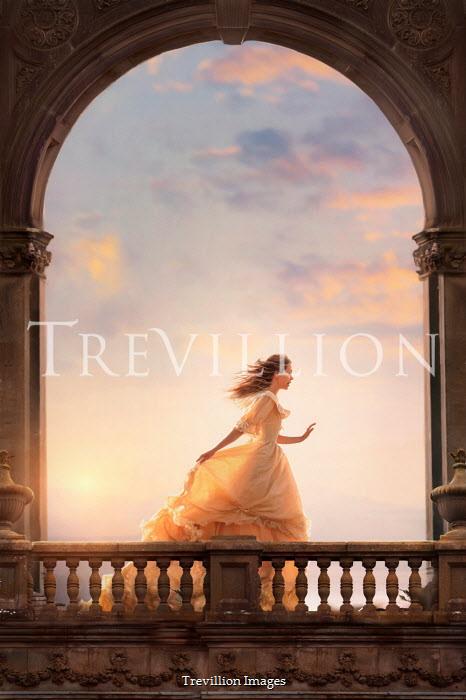 Lee Avison victorian woman running beneath a stone archway at sunset